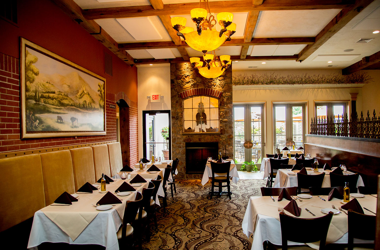 Our fireplaced dining room opens out to our private Tuscan patio.